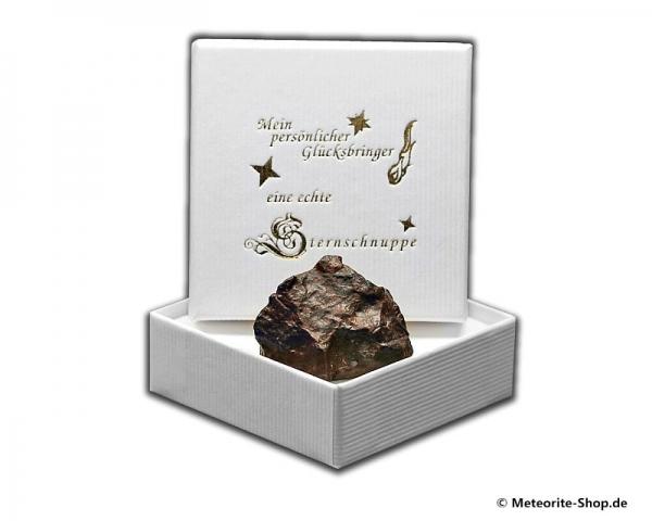 Glücksbringer-Sternschnuppe als Steinmeteorit in weißer Glücksbringer-Geschenkbox
