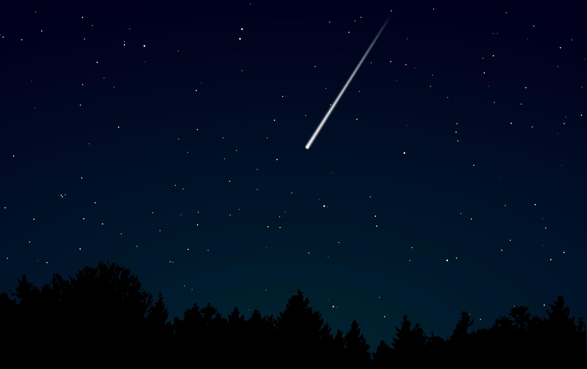Leuchtstreifen einer Sternschnuppe am Nachthimmel